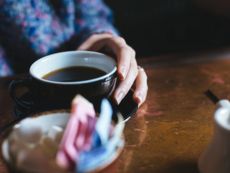 Photo: Voices blog hand holding coffee