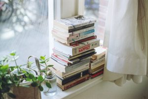 Photo: Stack of Books Caregivers Bookshelf