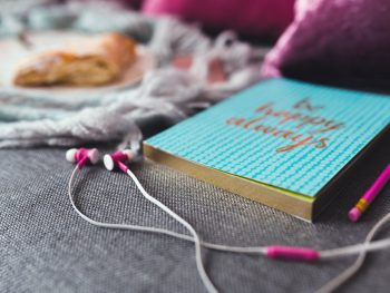 ear buds laying next to a journal