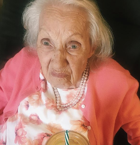 the author's grandmother making a fussy face about drinking water