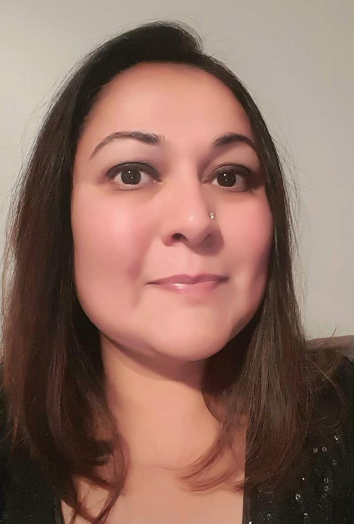 headshot of Premal Jani, owner of Surrogate Family Care