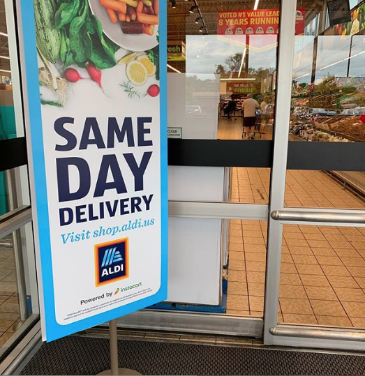 same day delivery sign in front of Aldi grocery store