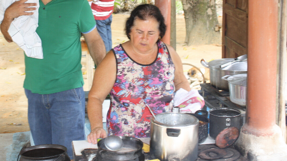 woman cooking food over two pots