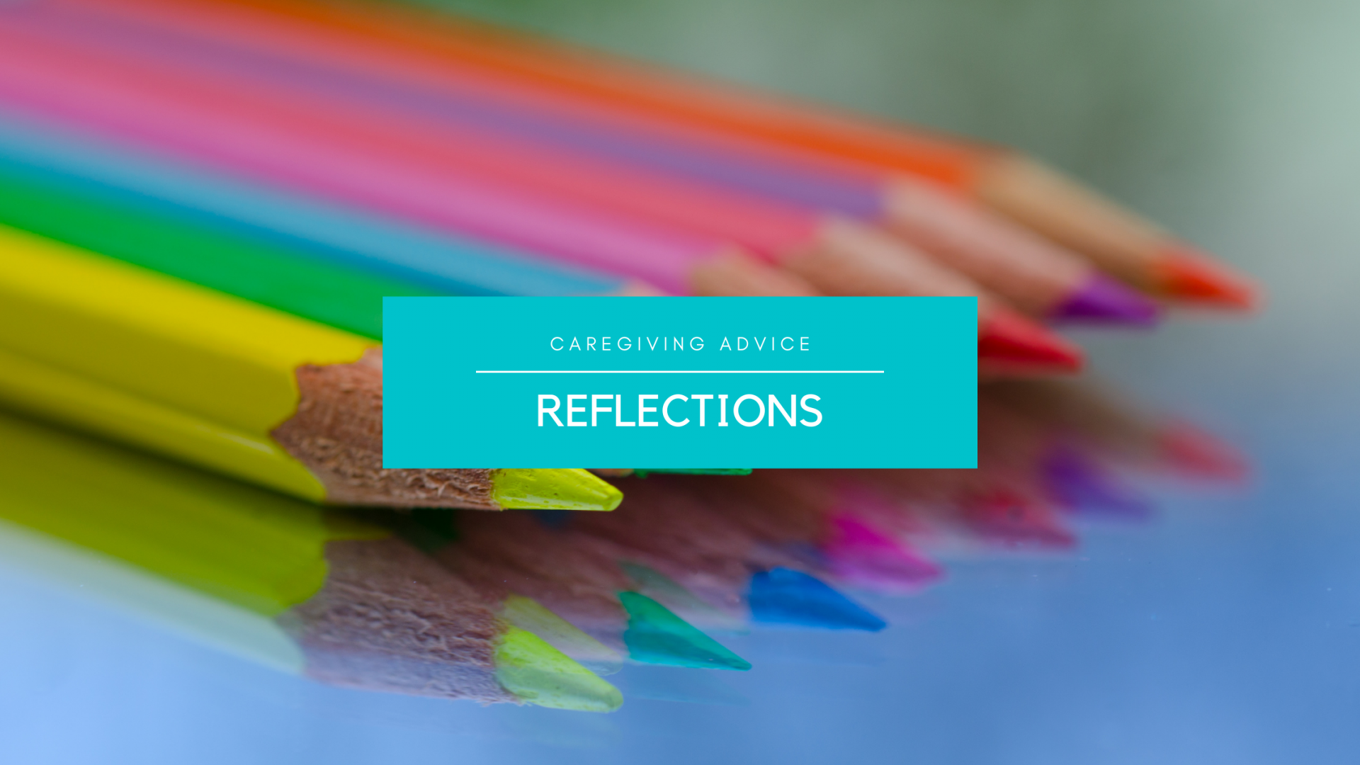 image of brightly colored pencils on reflective surface